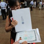 Sunheang Bun shows off her naturalization certificate. Bunthay Cheam,  2012.